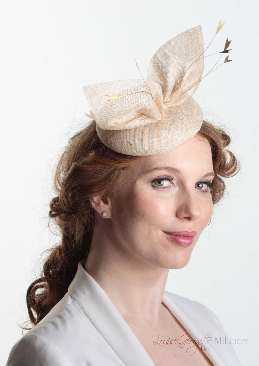 Hayley small disc Hat with bow detail in natural straw. Model side view. Hand