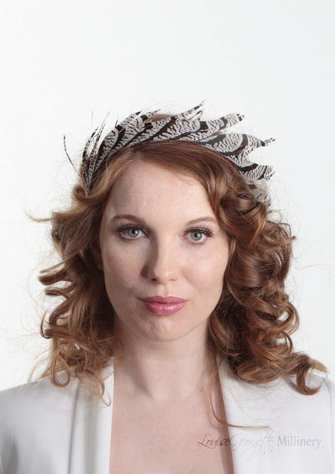 Ivory and Brown/Black stripped feather headband. Model front view. Handmade millinery made in London.