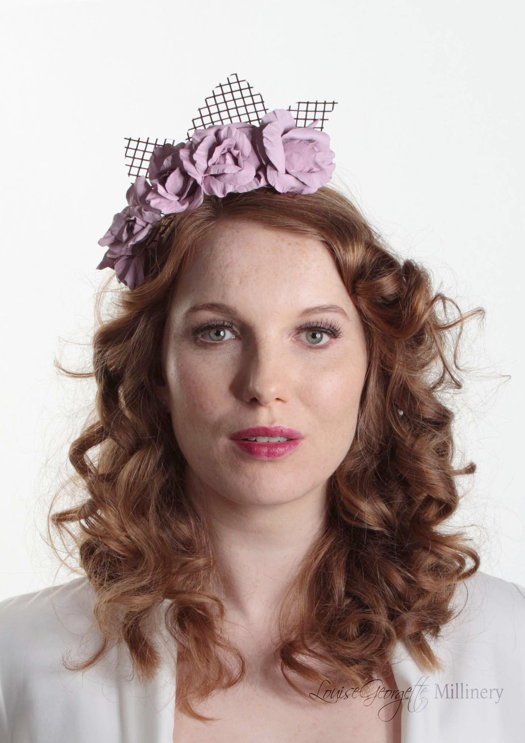 Rosie pale lilac leather flower crown on lattice. Model front view. Millinery handmade in London.