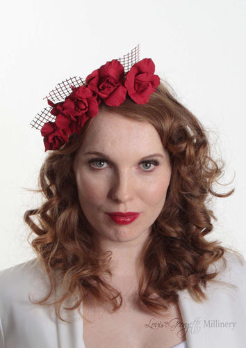 Patterned Leather roses on headband with reflective lattice detail. Millinery handmade in London. Front view on model.
