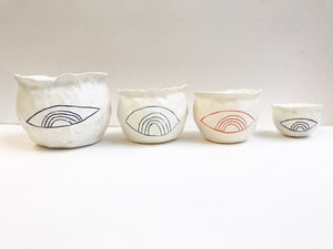 sold talisman containers; set of 4 rainbow/eye design