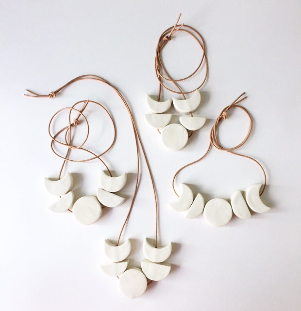 'loyal companion' mini moon phases all white ceramic necklace