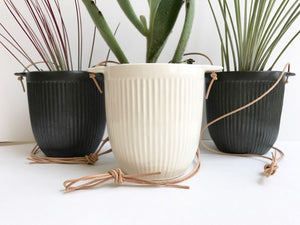 white or black hanging planter