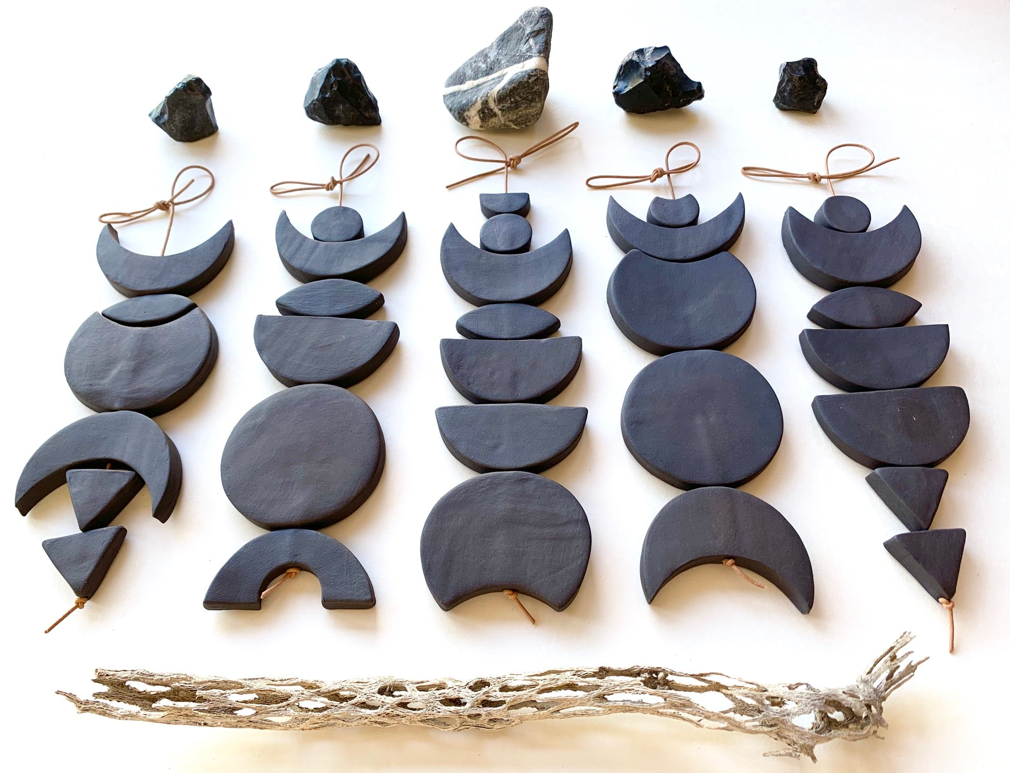 one of a kind, black magic ceramic wall hanging