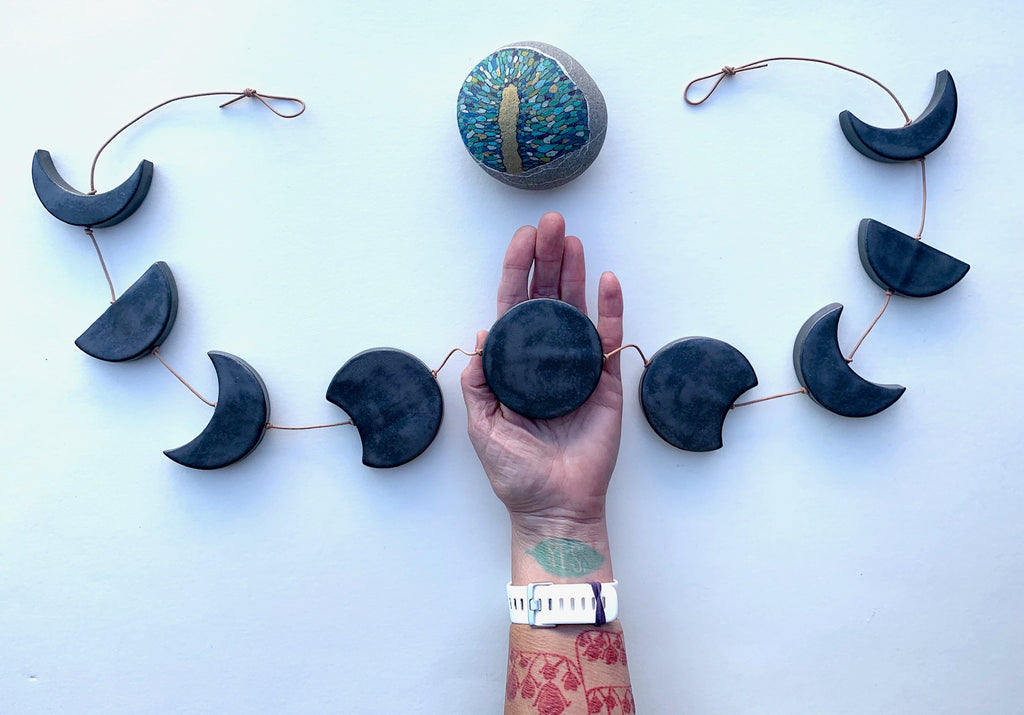horizontal, ceramic 'black magic' moon wall hanging