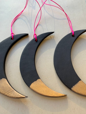 sold - black gold dipped moon ornament