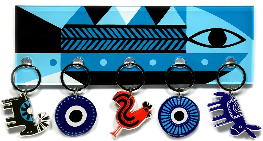 Keyholder with Fish design. Made of Plexiglass. with wall mounting hardware included  Made in Greece.