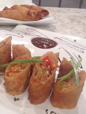 Egg rolls de vegetales y king crab