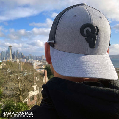 BRANDON DINOVI wearing a RAM ADVANTAGE premium HEATHER GREY and BLACK 3D embroidered TRUCKER HAT overlooking the SEATTLE  skyline