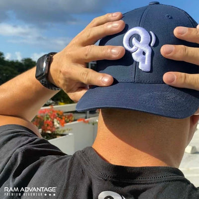 JEREMY SAGE wearing a RAM ADVANTAGE premium NAVY and WHITE 3D embroidered TRUCKER HAT