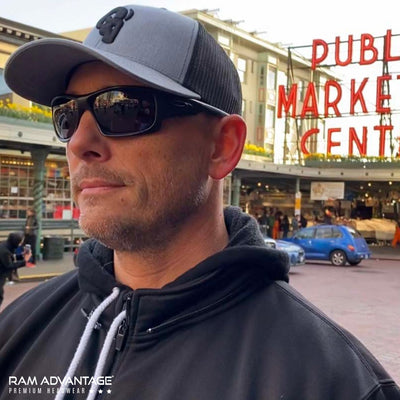 BRANDON DINOVI wearing a RAM ADVANTAGE premium HEATHER GREY and BLACK 3D embroidered TRUCKER HAT in SEATTLE  at PIKE PLACE MARKET