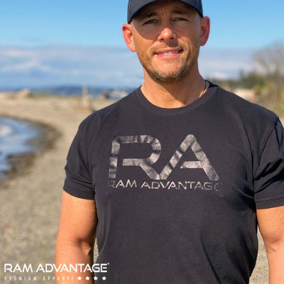 BRANDON DINOVI wearing an ultra-soft RAM ADVANTAGE t-shirt on the BEACH.