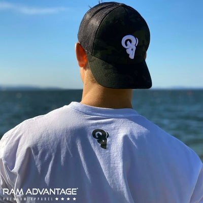 JEREMY  SAGE wearing a ultra-soft RAM ADVANTAGE t-shirt. Handsome MUSCULAR  MAN overlooking  the beach wearing a BLACK  CAMO TRUCKER HAT