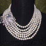 Natural fresh water pearl 6 layer necklace with 925 sterling silver and cubic zirconia accent.