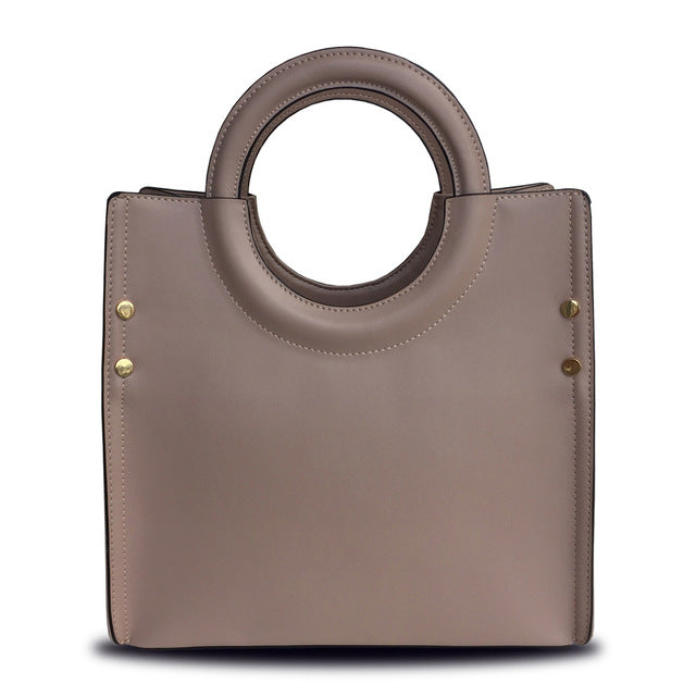 f1d8b909b7 Genuine Leather Women Handbag with circular handle. - bulk offers