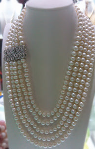 Fashionable  4 rows Freshwater White Pearl necklace. AA 9-10 mm