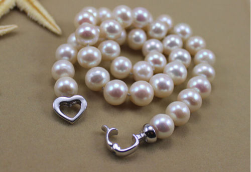 One of a kind South Sea 9-10 mm white pearls 18 inch necklace with Sterling Silver Clasp.