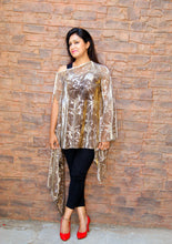 A copper sheer poncho top