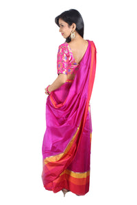 Rani colour silk handwoven sari with red striped drape and border