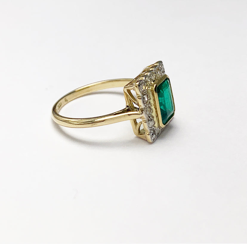 18ct Gold Emerald and Sixteen Diamond Ring