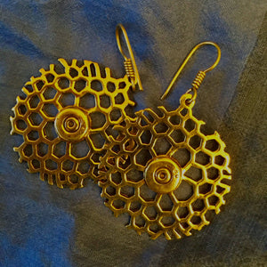 Bomb and bullet casings recycled brass earrings handmade in Cambodia supporting disadvantaged communities