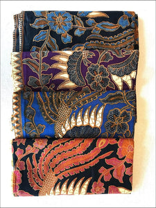 Beautiful Balinese hand printed blue and brown on a black background batik cotton sarongs - Samsara Online