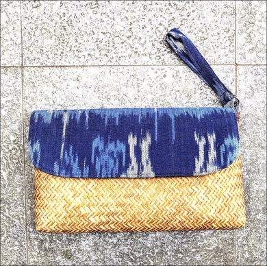 Handmade handwoven blue ikat cotton fabric and woven palm leaf clutch bag 28cmx19cm with strap, lining and snap closure - Samsara Online