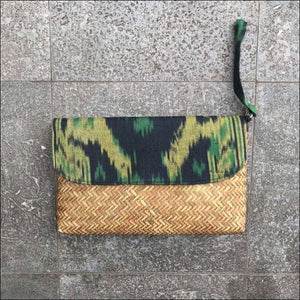 Handmade handwoven green and black cotton ikat and palm leaf clutch bag lined with snap closure and strap 19cmx28cm - Samsara Online