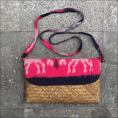 Handmade handwoven pink ikat fabric and palm leaf clutch bag 19cmx28cm lined with snap closure and strap - Samsara Online