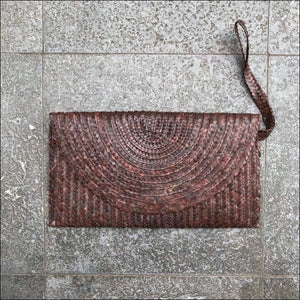 Handmade palm leaf brown clutch bag from Bali, lined, snap closure, with strap and zip internal pocket 16cmx27cm - Samsara Online