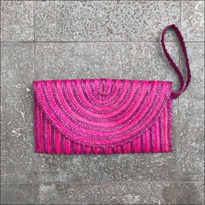 Handmade palm leaf dark pink clutch bag from Bali, lined, magnetic closure, with strap and zip internal pocket 16cmx27cm - Samsara Online