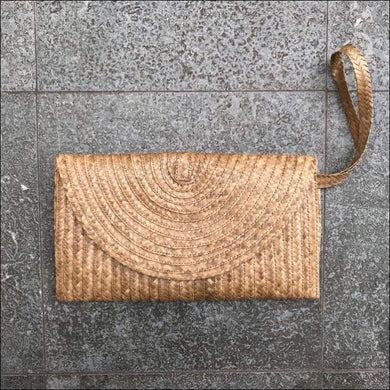 Handmade palm leaf natural colour clutch bag from Bali, lined, snap closure, with strap and zip internal pocket 16cmx27cm - Samsara Online