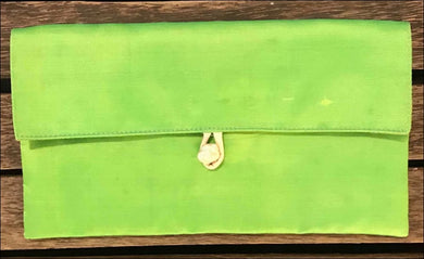 Lime green pure silk clutch bag handmade by disabled Cambodians. Lined with toggle closure 22cm x 12 cm. - Samsara Online
