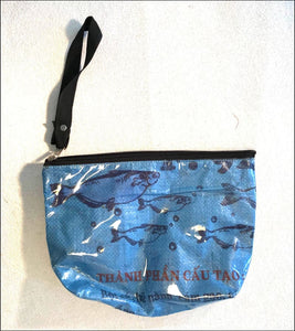 Lined waterproof blue cosmetics, toiletries or toothbrush bag handmade from recycled rice bags fair trade from Cambodia - Samsara Online