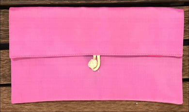Pink pure silk clutch bag purse, lined with toggle closure, handmade by disabled Cambodians. 22cm x 12 cm. - Samsara Online