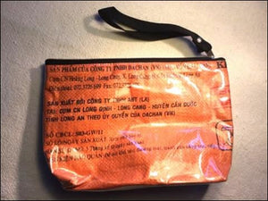 Waterproof lined orange and black cosmetics, toiletries or toothbrush bag with zip handmade from recycled rice bags fair trade from Cambodia - Samsara Online