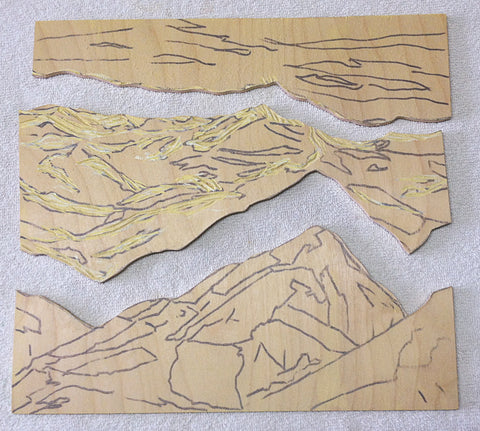 Block for Turning Tide, a jigsaw reduction woodblock print by artist Hannah Phelps