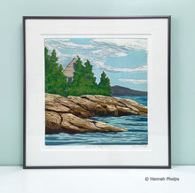 Framed jigsaw reduction woodblock print of a summer home in Maine by artist Hannah Phelps