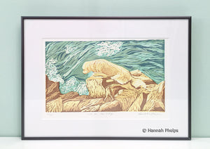 Framed jigsaw print of a dog on the rocky coast of Maine by New England artist, Hannah Phleps