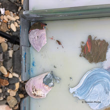 Close up of artist Hannah Phelps' oil painting pallette and the shells she had to use as tools one day.