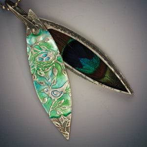Vickie Hallmark | Peacock Locket | fine silver, 23k gold, enamel, resin, feather