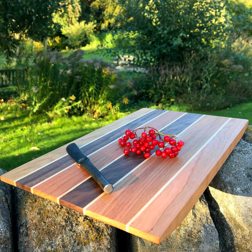 Cheeseboard with knife and berries