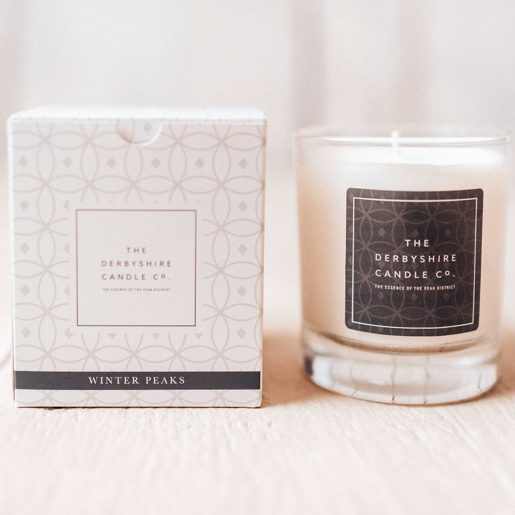 Scented candle winter peaks