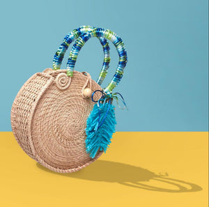 Katty del Mar Iraca with Blue Feather Bag