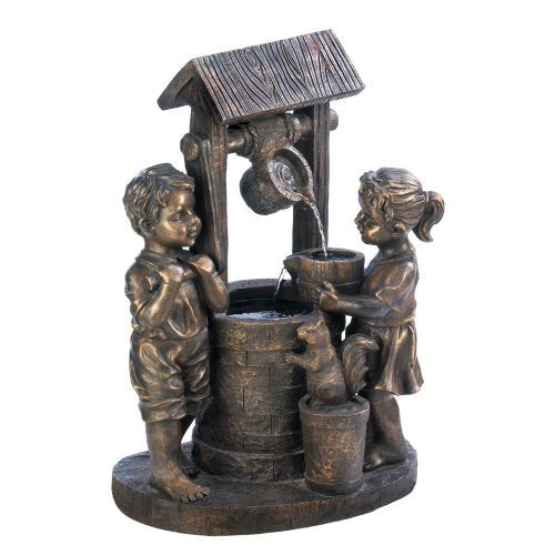 Bronze looking boy and girl at a wishing well drawing water.