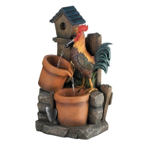 Rooster  standing on a flower pot. This Back Yard Scene Rooster Water Fountain with 2 Planters is a charming water fountain that will delight you and your guests! The stony backyard scene features a little birdhouse, two planters, and a strutting rooster waiting for a fresh drink of flowing water!