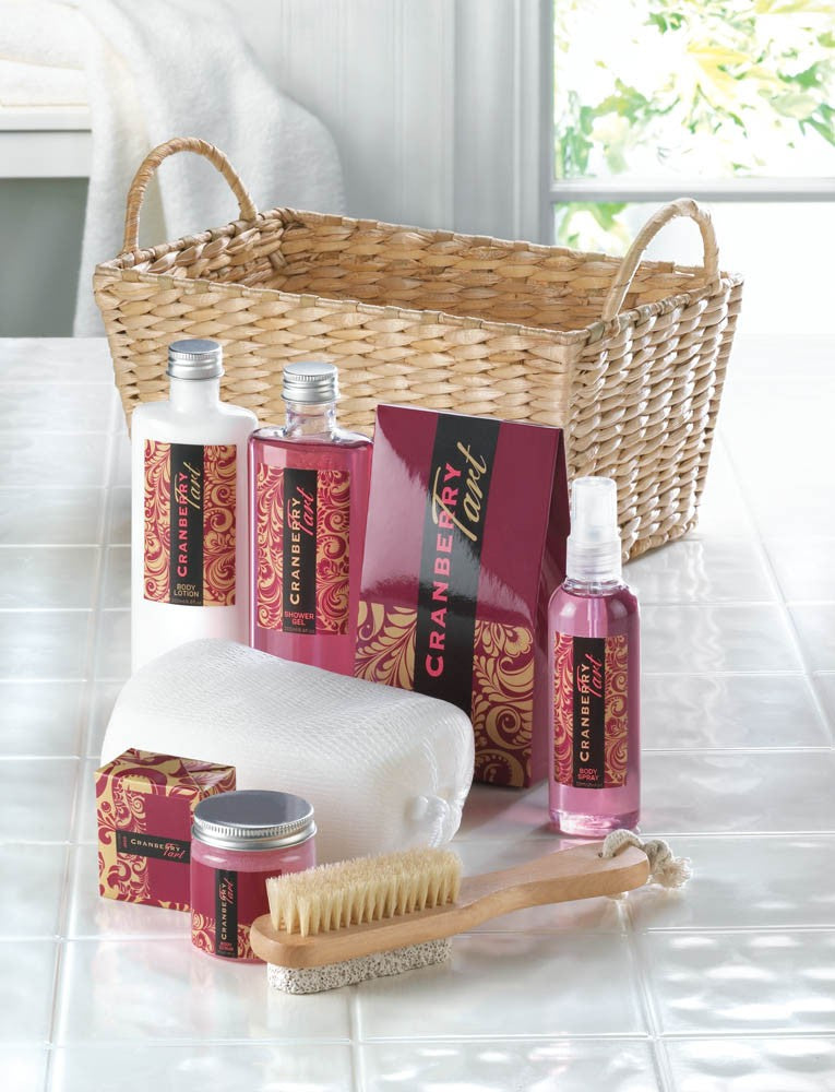 light brown basket of spa products with the red and white products displayed in front of the basket.