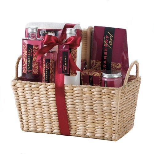 light brown basket of spa products with the red and white products displayed in the basket.