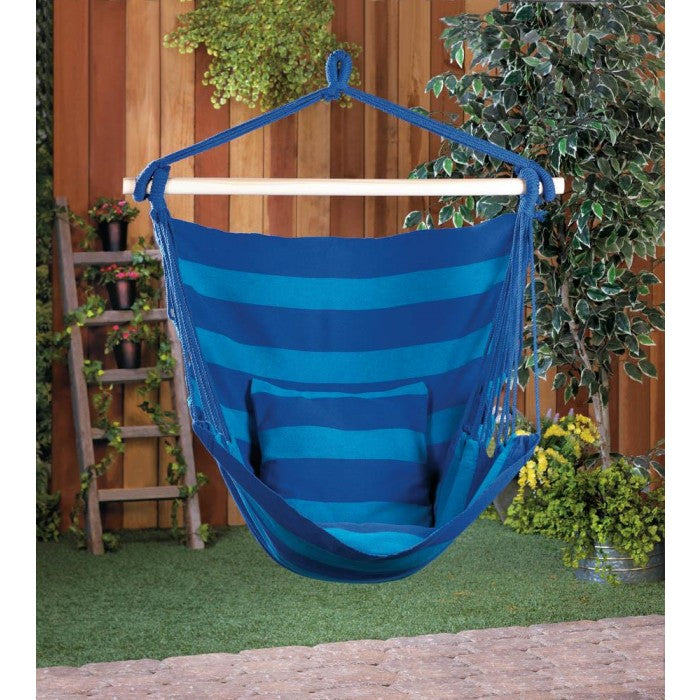 A blue striped hammock chair in an outdoor setting.