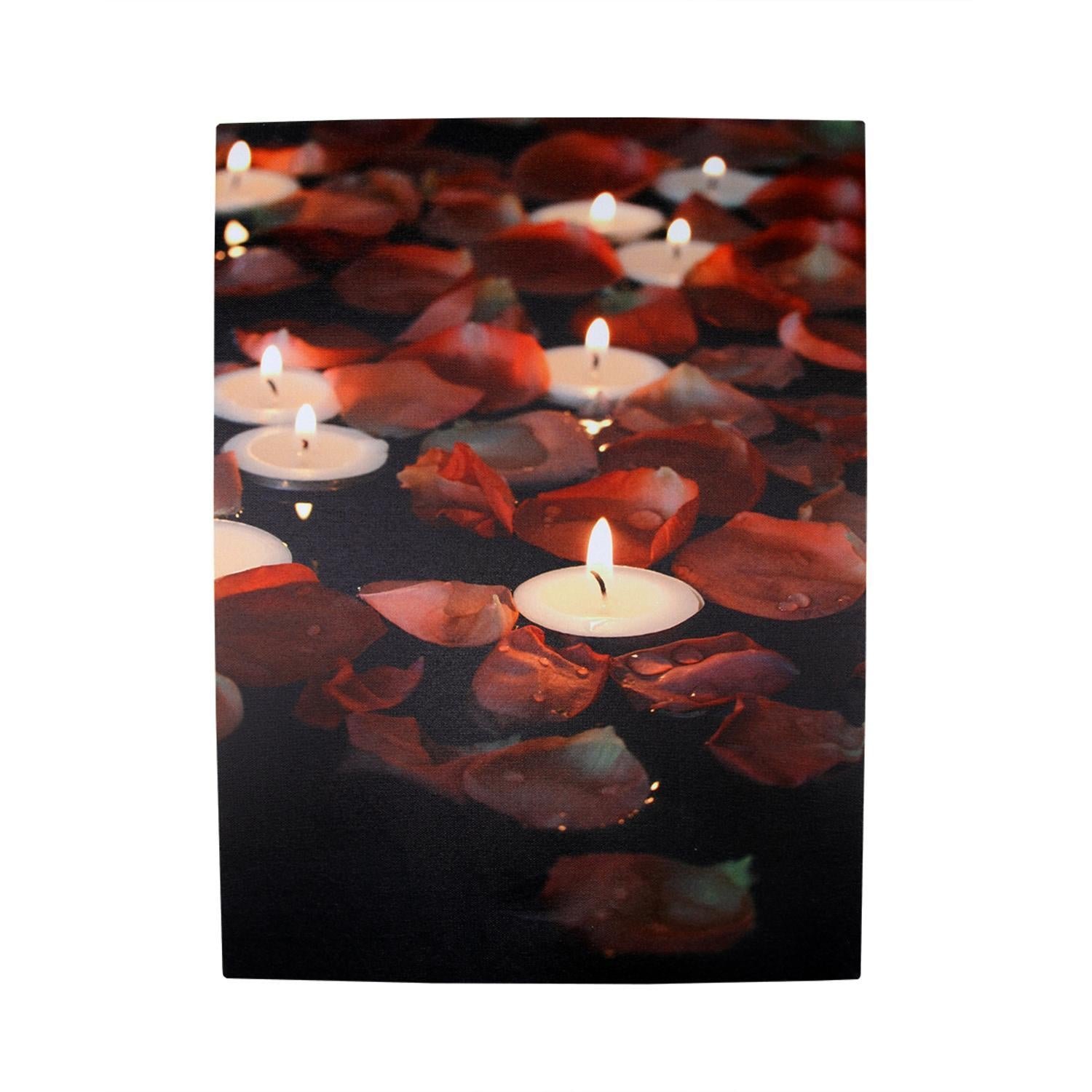 red and white candles and flowers floating in water.